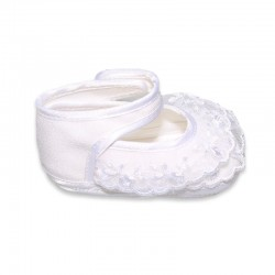 White Baby schoes with lace ruffles and flower at the fastener